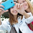 Two friends taking photos with a smartphone — Stock Photo