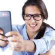 Cute brunette woman taking photo of herself — Stock Photo