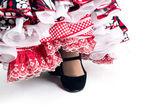 Feet detail of Flamenco dancer in beautiful dress — Zdjęcie stockowe