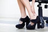 Businesswoman massaging her foot — Stock Photo