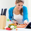Stock Photo: Pretty young woman cooking at home