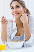 Woman eating cereals in the morning — Stock Photo
