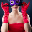 Stock Photo: Sophisticated womwith red dress and carnival mask