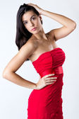 Sophisticated young woman with red dress — Stock Photo