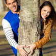 Happy young couple in love having fun at the park — Stok fotoğraf