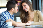 Young couple in love at a coffee shop — Stock Photo