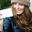 Cute brunette woman taking photo of herself on the street — Stok fotoğraf