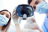 Cute young woman at the dentist. Mouth checkup — Stock Photo