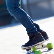 Legs of young boy skating down the street — Stock Photo #41955623