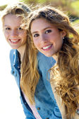 Beautiful young girls looking at the camera — Stock Photo