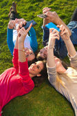 A group of friends taking photos with a smartphone — Stock Photo