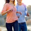 Happy young couple runnig together in the park — Stock Photo