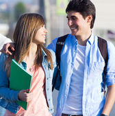 Happy young couple in the street after class — Stock Photo