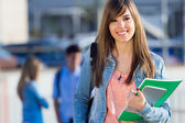 Young student girl looking at the camera — Stock Photo