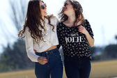 Young beautiful girls with denim suit in a urban background — Stock Photo