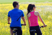 Happy young  couple on a bike ride in the countryside — Stock Photo