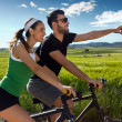 Happy young  couple on a bike ride in the countryside — Stock Photo #45963651