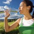 Woman drinking water after sport activities — Stock Photo #45966507