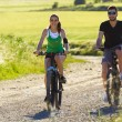Happy young couple on a bike ride in the countryside — Stock Photo #45966977