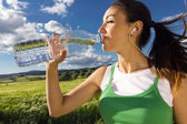 Woman drinking water after sport activities — Stockfoto