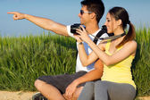 Happy Young couple taking photos in the field — Stock Photo