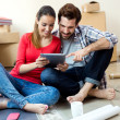 Young couple with digital tablet in their new home — Stock Photo #47062989