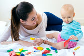 Baby girl and her mother playing at home — Stock Photo