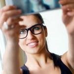 Cute brunette woman taking photo of herself — Stock Photo #47374309