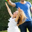 Happy young family, father and son playing ball in the park. — Stock Photo #47851031