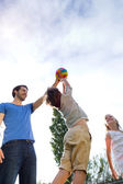 Happy young family, father and son playing ball in the park. — Stock Photo