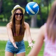 Pretty young woman playing with a ball in the city park - Sunset — Stock Photo