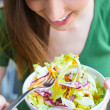 Woman eating salad. Portrait of beautiful smiling and happy Cauc — Stock Photo #48195061