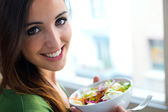 Woman eating salad. Portrait of beautiful smiling and happy Cauc — Stock Photo