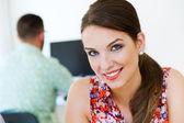 Beautiful businesswoman posing at camera in office. — Stock Photo