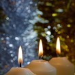 Foto Stock: Candles with Sparkling Tinsel Background