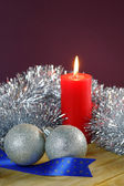 Christmas Baubles and Candle with Tinsel — Stock Photo