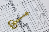 Antique Key on House Plan — Stock Photo