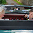 Mature Married Couple in a Classic Sports Car — Stock Photo #47063041