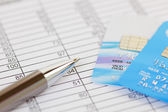 Pen and Credit Cards on a Financial Spreadsheet — Stock Photo