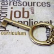 Golden key on job text — Stock Photo