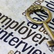 Old key on employer text — Stock Photo