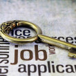 Golden key on job text - Stock Photo