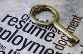 Golden key on resume text — Stock Photo