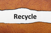 Recycle text on torn paper — Stock Photo
