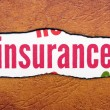 Insurance text on torn paper — Stock Photo