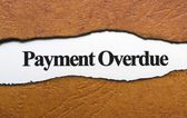 Payment overdue text on torn paper — Stock Photo