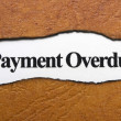 Stock Photo: Payment overdue text on torn paper