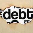 Debt text on paper hole - Stock Photo