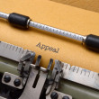 Appeal text on typewriter - Stok fotoğraf