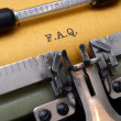 F.A.Q. on typewriter — Stock Photo